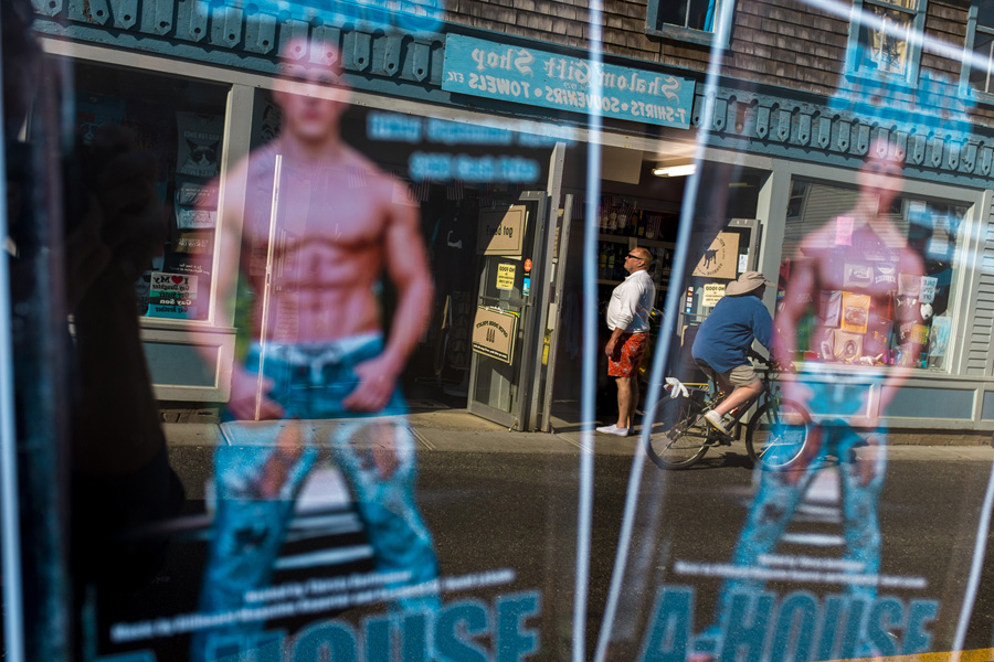 Reflection of leaflets for the local gay bar in Provincetown, MA
