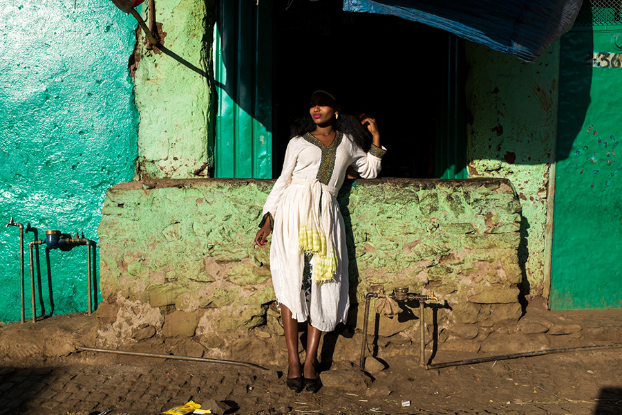 Timkat Gondar. Young woman taking a rest in the sun after the Tabot has return to its altar,